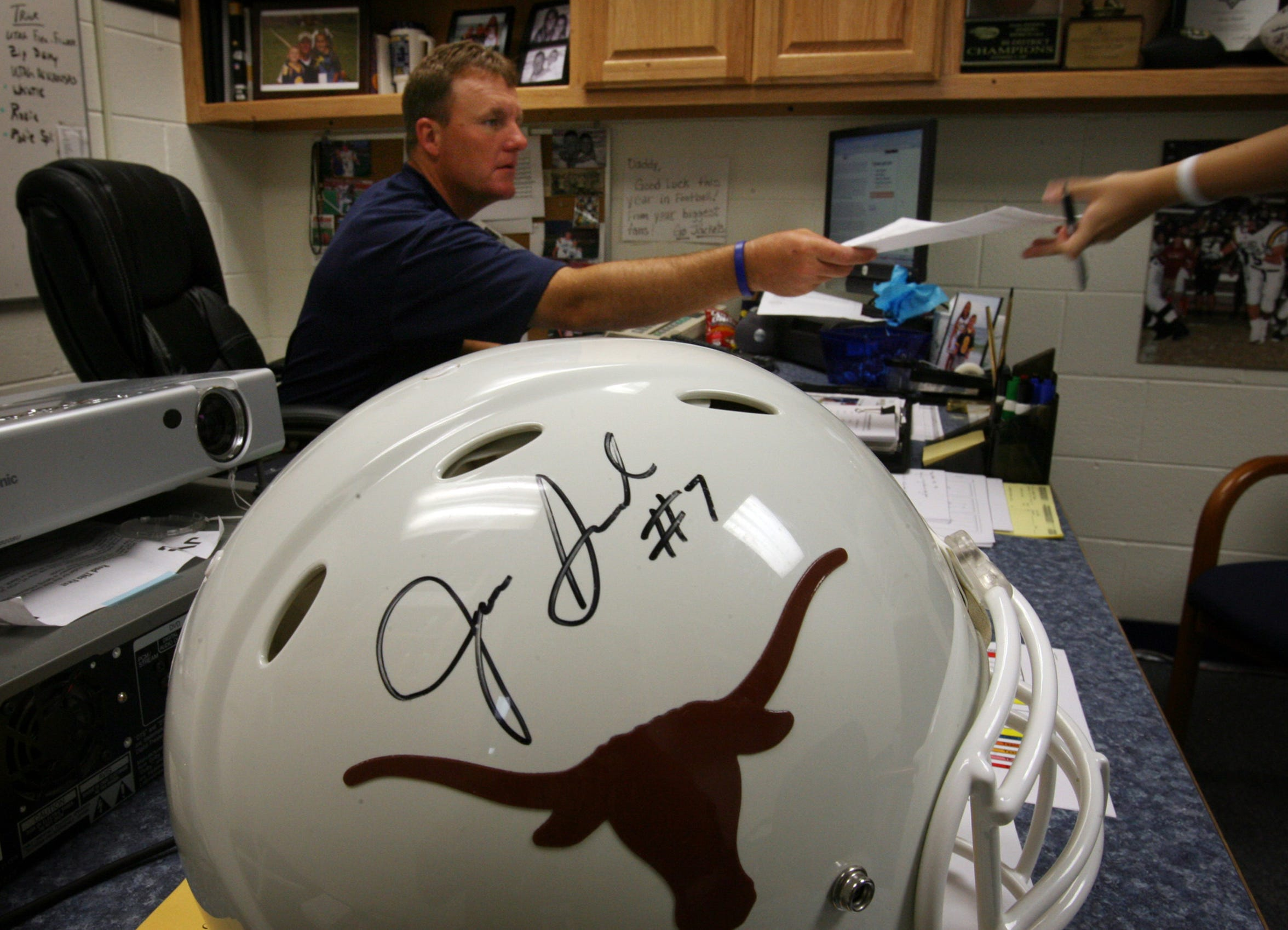 A Longhorn helmet autographed by Jevan Snead sits on the desk of his high school coach Chad Morris at Stephenville High School in Stephenville on Wednesday, Aug. 23, 2006.