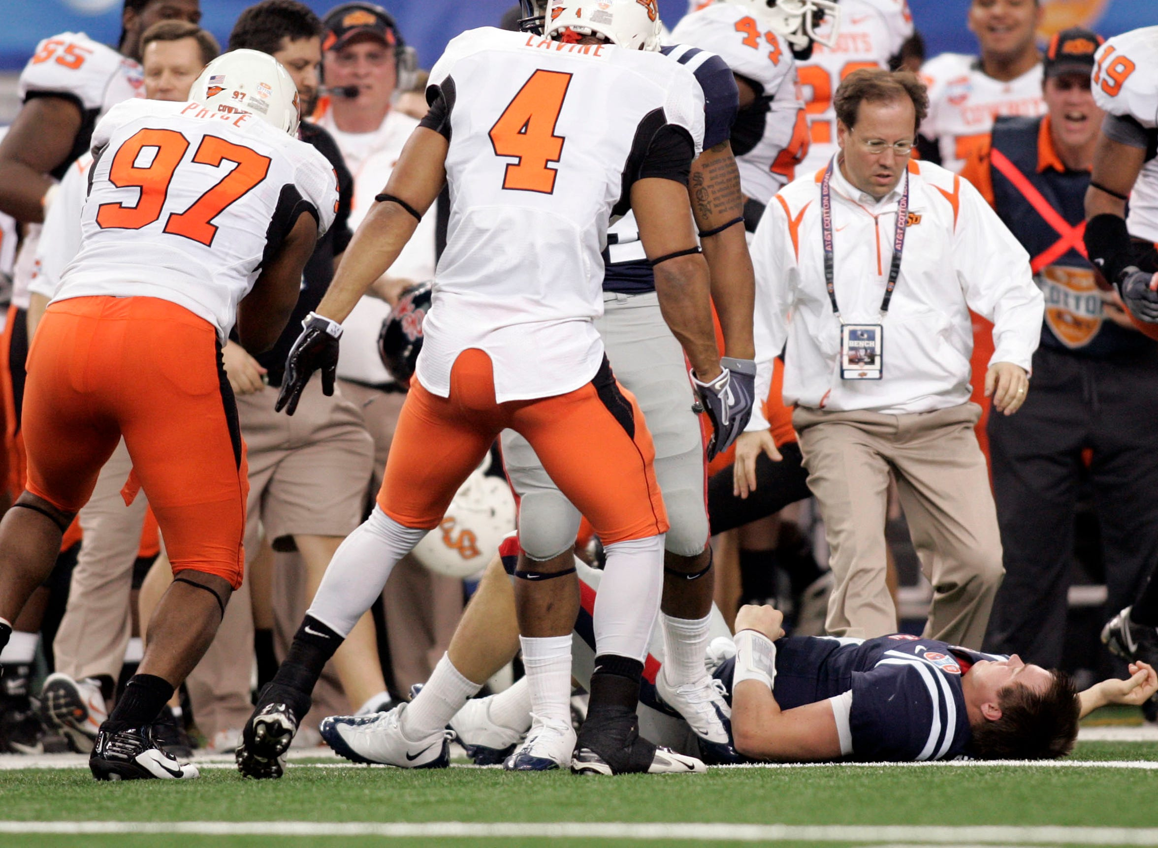 Mississippi Rebels quarterback Jevan Snead lays on the field after being blocked against the Oklahoma State Cowboys during the Cotton Bowl Bowl at Cowboys Stadium in Arlington on Jan. 2, 2010.