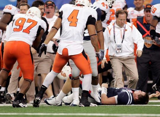 Ole Miss quarterback Jevan Snead lays on the field after being blocked against the Oklahoma State Cowboys during the Cotton Bowl Bowl at Cowboys Stadium in Arlington on Jan. 2, 2010.