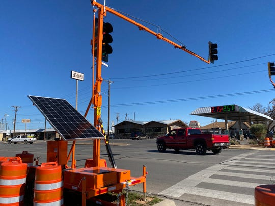 Portable traffic signals towered above the intersection of South Koenigheim and West Harris Avenue Wednesday, Jan. 29, 2020. The temporary signals were purchased for nearly $75K by the City of San Angelo to help curb frequent crashes that occurred after a motorist damaged a traffic signal on Jan. 5.