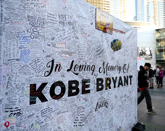 Jan 28, 2020; Los Angeles, California, USA;  Fans leave messages on memory boards at Staples Center to remember the late Kobe Bryant who perished in a helicopter crash on Jan 26, 2020.  Mandatory Credit: Jayne Kamin-Oncea-USA TODAY Sports