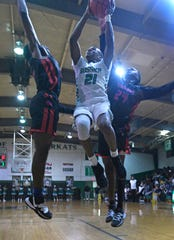 Bossier's Cody Deen goes up for two against Woodlawn in a non-district game Tuesday.