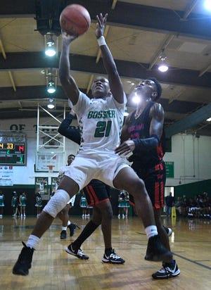 Bossier's Cody Deen shoots against Woodlawn in a non-district game Tuesday.