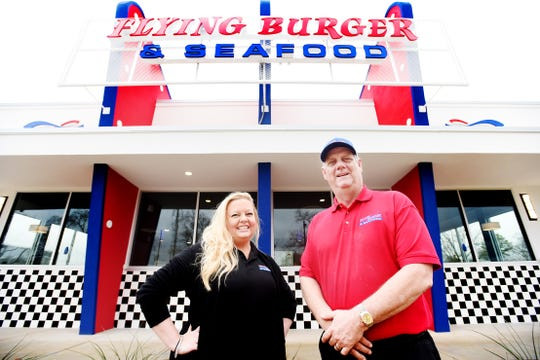 Flying Burger and Seafood's Portraits of the founder Robert Smith and general manager Lori Hollis.
