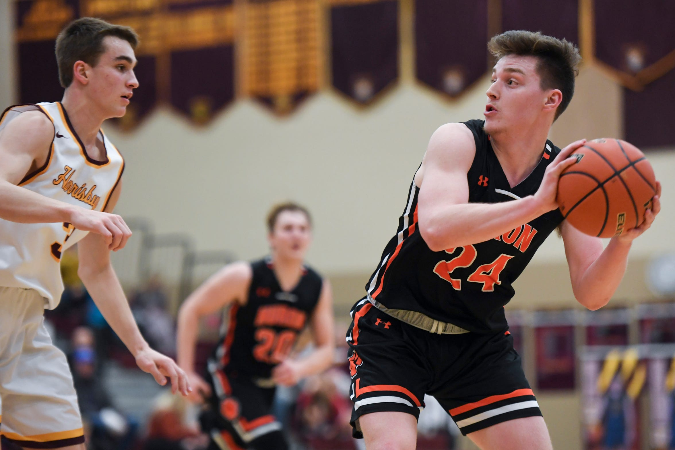 Huron's Kobe Busch (24) looks to make a pass during the game against Harrisburg on Tuesday, Jan. 28, 2020 at Harrisburg High School.