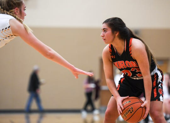 Huron's Havyn Heinz (23) looks to make a pass during the game against Harrisburg on Tuesday, Jan. 28, 2020 at Harrisburg High School.
