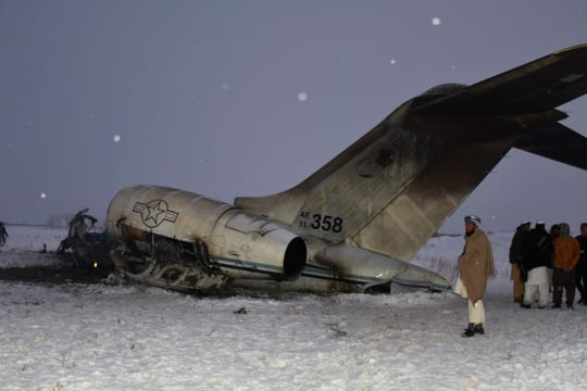 A wreckage of a U.S. military aircraft that crashed in Ghazni province, Afghanistan, is seen Monday, Jan. 27, 2020. The aircraft crashed in Ghazni province on Monday, A U.S. military aircraft crashed in eastern Afghanistan on Monday, an American official said, adding that there were no indications so far it'd been brought down by enemy fire.