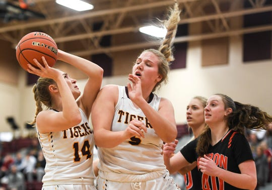 Harrisburg's Brecli Honner (14) rebounds the ball during the game against Huron on Tuesday, Jan. 28, 2020 at Harrisburg High School.