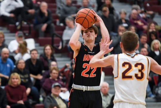 Huron's Teegan Evers (22) shoots a three pointer during the game against Harrisburg on Tuesday, Jan. 28, 2020 at Harrisburg High School.