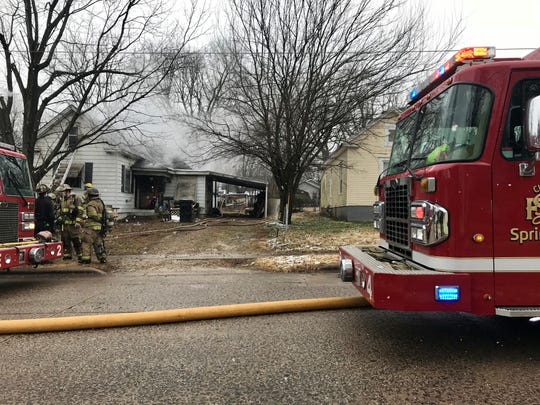 Crews work the scene of a house fire on Oakland Avenue.