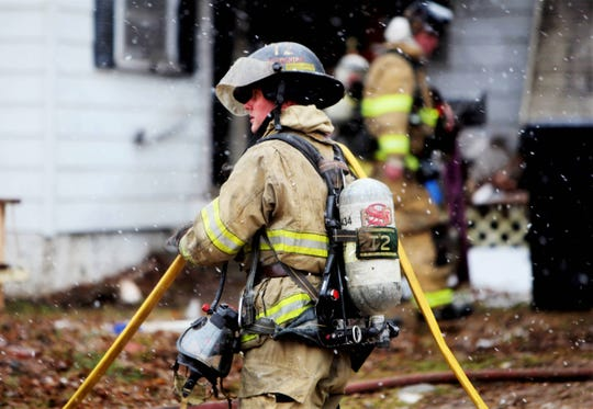 Springfield firefighters respond to the scene of a house fire Jan. 29, 2020, in the 2100 block of north Oakland Avenue.