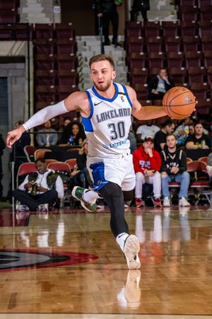 Andrew Rowsey of the Lakeland Magic dribbles the ball during the game against the Mississauga Raptors 905 at the Paramount Fine Foods Centre on January 20, 2020 in Mississauga, Ontario.