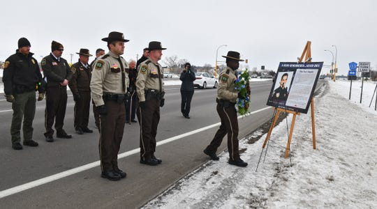 Stearns County Sheriff's Office honor guard members place a wreath Wednesday, Jan. 29, 2020, at the location where officer Brian Klinefelter was killed 24 years ago in St. Joseph.
