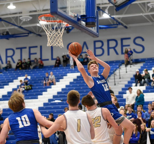Sartell sophomore Mason Lund is fouled on a shot Tuesday, Jan. 28, 2020, at Sartell High School.