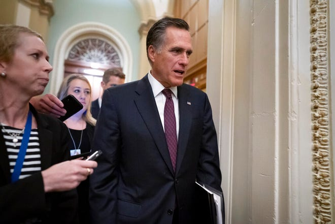 Sen. Mitt Romney, R-Utah, arrives as defense arguments by the Republicans resume in the impeachment trial of President Donald Trump on charges of abuse of power and obstruction of Congress, at the Capitol in Washington, Tuesday, Jan. 28, 2020. (AP Photo/J. Scott Applewhite)