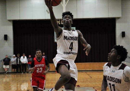 Madison County junior Zarrion Robinson goes up for a finger-roll layup as Madison County's boys basketball team beat Munroe 59-54 in overtime on Jan. 28, 2020.