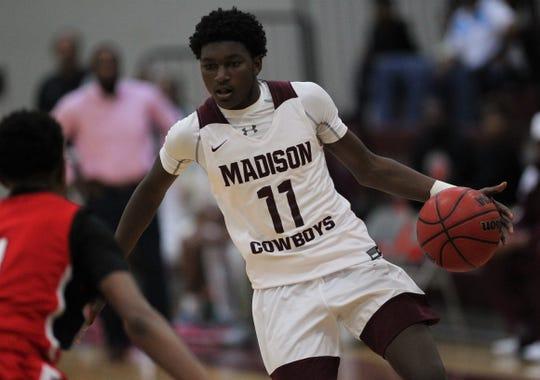 Madison County junior Zechariah Jones dribbles up court as Madison County's boys basketball team beat Munroe 59-54 in overtime on Jan. 28, 2020.