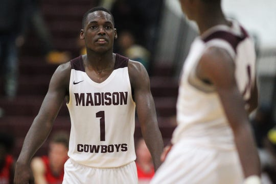 Madison County senior Demarvion Brown flexes at a teammate as Madison County's boys basketball team beat Munroe 59-54 in overtime on Jan. 28, 2020.