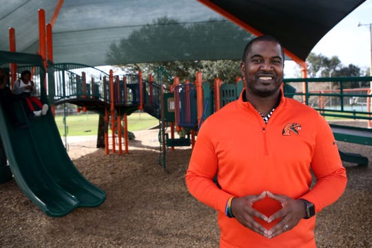 FAMU head football coach Willie Simmons poses for a photo on the playground outside the Walker Ford Community Center.