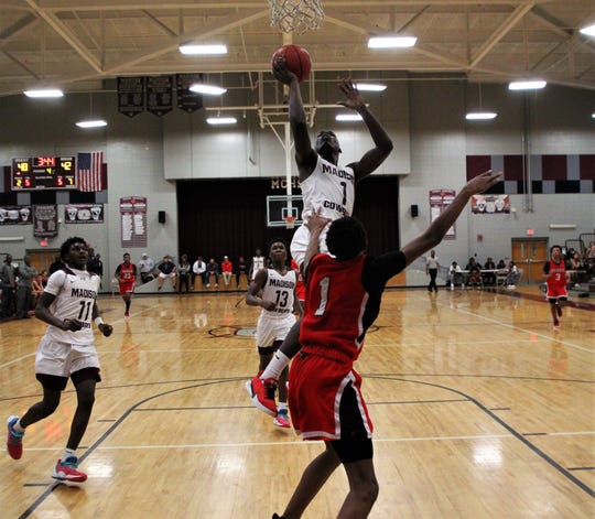 Madison County senior Demarvion Brown goes up for a transition layup as Madison County's boys basketball team beat Munroe 59-54 in overtime on Jan. 28, 2020.