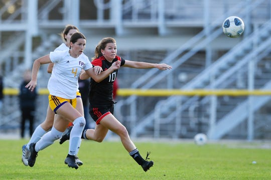 Vero Beach High School forward Madelaine Rhodes (10) fights for position against Fort Pierce Central on Tuesday, Jan. 28, 2020, in a District 9-7A soccer tournament semifinal at South County Regional Stadium in Port St. Lucie. Vero Beach won the game 8-0.