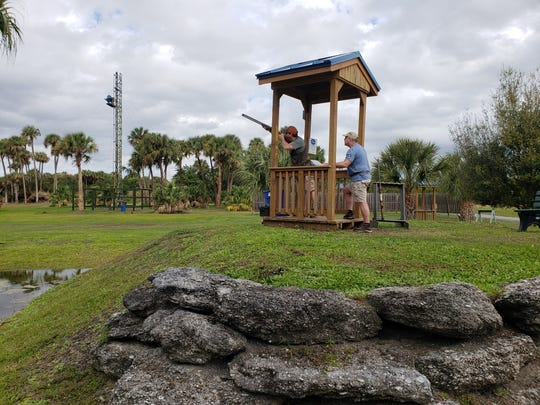 Andy Deth, left, and Bob Durocher, right, both from Vermont, practice at station No. 1 at the Vero Beach Clays Shooting Sports club in Vero Beach.