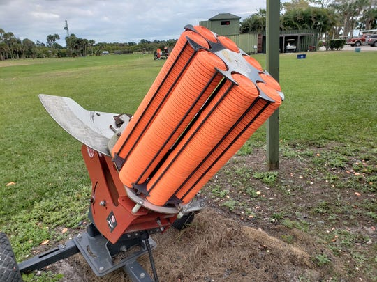 Clay targets, ready to be broken, are loaded into this target thrower at Vero Beach Clays Shooting Sports.