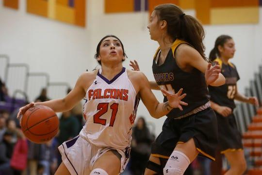Eastlake's Vanessa Herrera goes against Eastwood defense during the game Tuesday, Jan. 28, in District 2-5A at Eastlake High School in El Paso.
