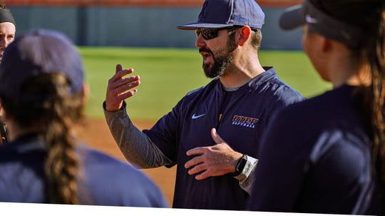 UTEP softball coach T.J. Hubbard instructs his team during a recent practice