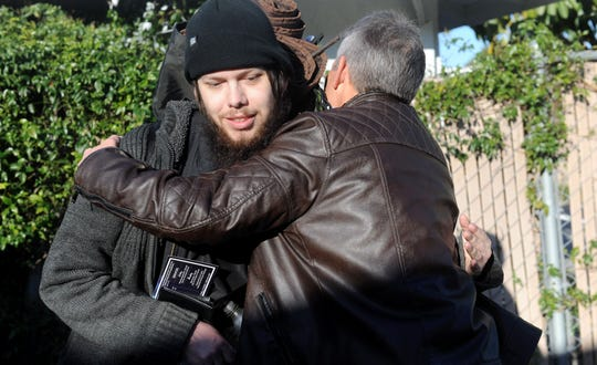Homeless Simi Valley resident Sean Thurman, left, gets a hug from volunteer Denny Beckham during the annual homeless count on Jan. 29, 2020.