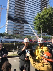 L.A. firefighters update media at the scene of a fire on Jan. 29, 2020, at a residential tower.