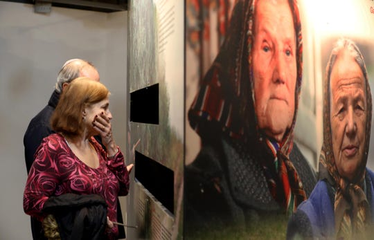 Karen Reis of West Nyack looks at an exhibit at the Holocaust Museum & Center for Tolerance and Education, located at Rockland Community College in Ramapo on Jan. 27, 2020. The museum recently reopened after a multi-year renovation.