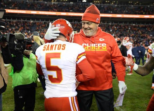 Nov 27, 2016; Denver, CO, USA; Kansas City Chiefs kicker Cairo Santos (5) and special teams coach Dave Toub celebrate the win over the Denver Broncos at Mile High. The Chiefs defeated the Broncos 30-27 in overtime. Mandatory Credit: Ron Chenoy-USA TODAY Sports