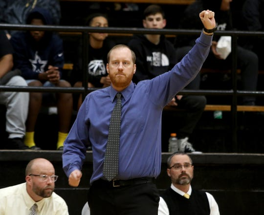 Rider head basketball coach Cliff McGuire signals to his players in the game against Abilene Wylie Tuesday, Jan. 28, 2020, at Rider.