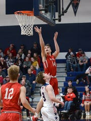 Logan Ranft goes up for a layup during the third quarter of Sheridan's 89-64 win against Morgan on Tuesday night in McConnelsville.