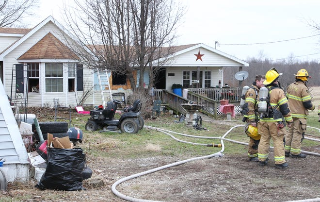 Firefighters from four departments fought a fire at 6305 Vroom Road, that displaced five people Wednesday morning.