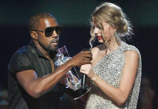 """Kanye West infamously takes the microphone from singer Taylor Swift as she accepts the best female video award during the MTV Video Music Awards in 2009. Swift revisits that moment and other aspects of their feud in """"Miss Americana."""""""