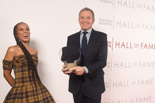 """Kerry Washington shares a moment with Disney CEO Bob Iger at the 25th Television Academy Hall of Fame honors Tuesday. Washington, who starred in ABC's """"Scandal,"""" introduced inductee Iger, praising the media executive as """"the ultimate Disney princess."""""""