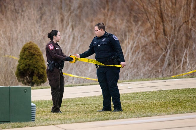 A Sangamon County Sheriff's deputy and a Rochester Police officer establish a perimeter near the scene of an airplane crash in Springfield, Illinois, Tuesday, Jan. 28, 2020. The Springfield Airport Authority confirmed that the plane went down shortly after 3 p.m. and was heading inbound towards Abraham Lincoln Capitol Airport. (Ted Schurter/The State Journal-Register)