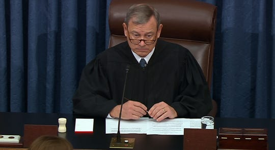 This still image taken from a US Senate webcast shows US Supreme Court Chief Justice John Roberts presides in the Senate Chamber at the US Capitol  on Jan. 28, 2020 in Washington, DC. - US President Donald Trump's lawyers urged the US Senate Tuesday to reject the charges against him Tuesday, closing their impeachment defense by accusing the Democrats of placing him on trial for political reasons.