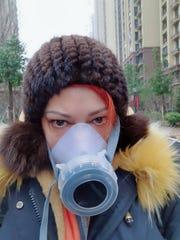 American Diana Adama wears a mask in Wuhan, China on Jan. 24, 2020.
