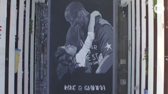 Kobe Bryant hugging daughter, Gianna drawn on basketball court