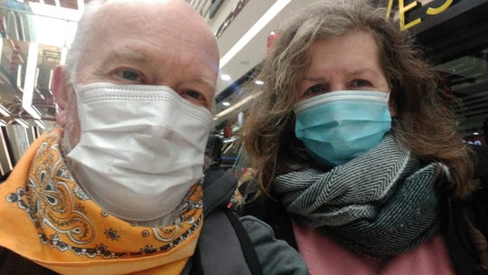 Teachers John McGory and Liz Jones wear masks in Wuhan, China on Jan. 25, 2020.