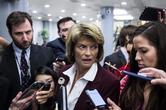 Sen. Lisa Murkowski, R-Alaska, leaves a closed-door Senate Republican caucus on Tuesday.