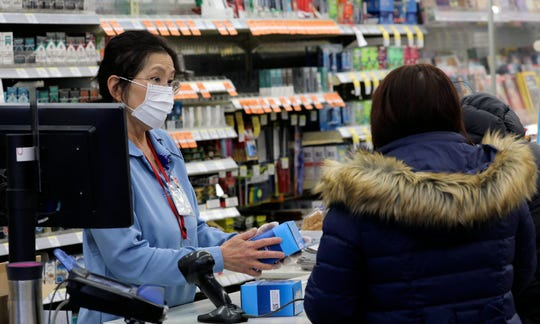Ringing up face masks at a pharmacy in Chicago on Jan. 24, 2020.