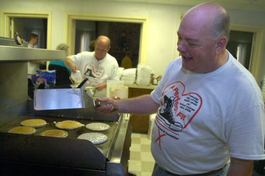 Willie Harp, founder of A Perfect Fit Foundation, flips pancakes Thursday at the organization's annual pancake breakfast fundraiser at St. James Episcopal Church in Alexandria.