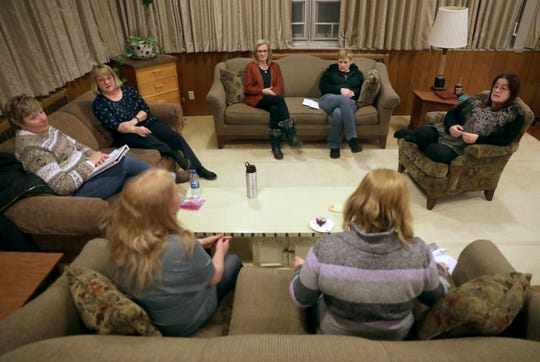 Lisa Stevenson, 48, of Kimberly, attends the volunteer-led Community Circles of Support group on Wednesday in Appleton. Stevenson has spent most of her life going in and out of prison, but has finally achieved a sense of stability after taking part in a program known as Opening Avenues to Reentry Success, which helps offenders living with mental illnesses transition to life outside prison.