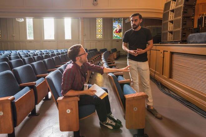 Post-Crescent reporter Shane Nyman, left, interviews musician Robert Ellis at the Lawrence Memorial Chapel in Appleton during Mile of Music in 2014.