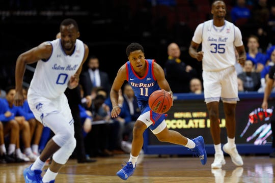 DePaul's Charlie Moore (11) dribbles the ball against Seton Hall's Quincy McKnight (0)during the first half of an NCAA college basketball game Wednesday, Jan. 29, 2020 in Newark, N.J.