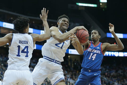 Jan 29, 2020; Newark, New Jersey, USA; Seton Hall Pirates center Ike Obiagu (21) rebounds the ball against DePaul Blue Demons center Nick Ongenda (14) in front of guard Jared Rhoden (14) during the first half at Prudential Center.